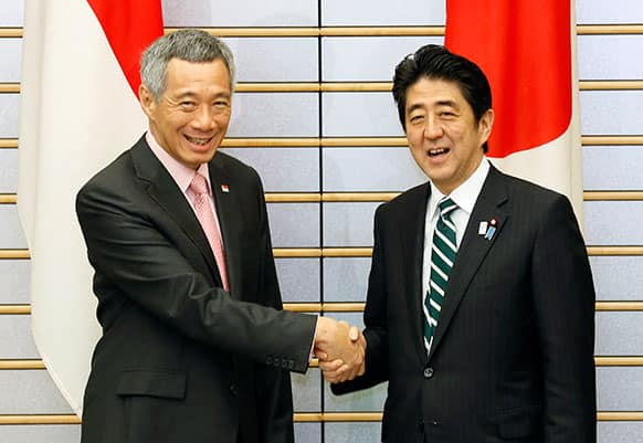 Singapore`s Prime Minister Lee Hsien Loong, left, shakes hands with Japanese counterpart Shinzo Abe at the star of their talks at Abe`s official residence in Tokyo.