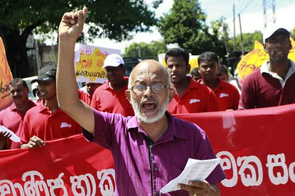 A Sri Lankan trade union activist shouts slogans during a protest in Ratmalana, on the outskirts of Colombo, Sri Lanka.