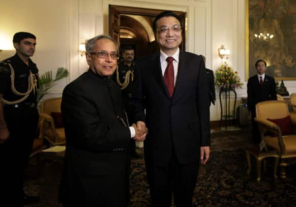 Chinese Premier Li Keqiang, poses with President Pranab Mukherjee before a meeting at the Indian Presidential Palace in New Delhi. Keqiang is on a three-day visit to discuss bilateral and trade ties.