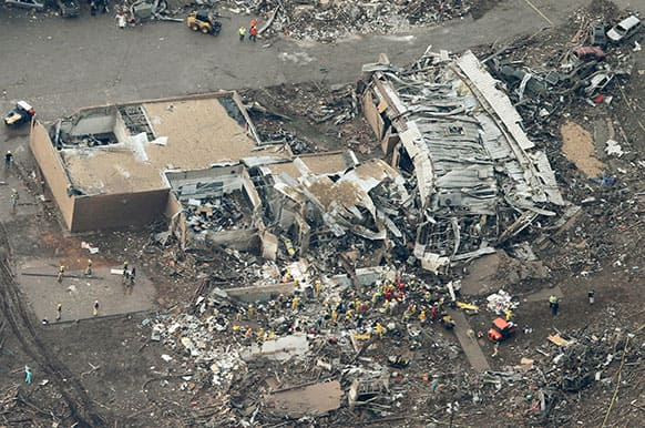 This aerial photo shows the remains of homes hit by a massive tornado in Moore, Okla.