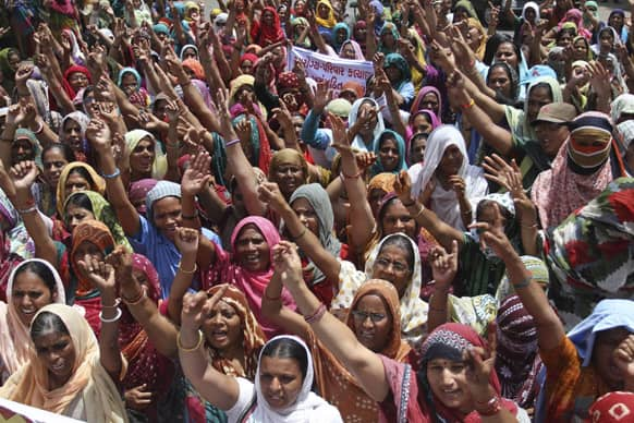 Health workers of Gujarat state, locally known as 'Link Workers' shout slogans during a protest in Ahmedabad.