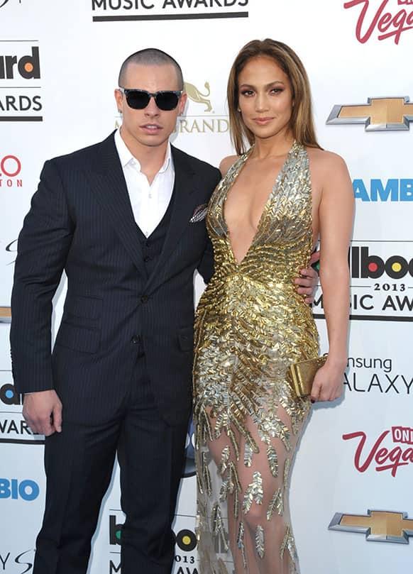 Casper Smart, left, and Jennifer Lopez arrive at the Billboard Music Awards at the MGM Grand Garden Arena in Las Vegas.