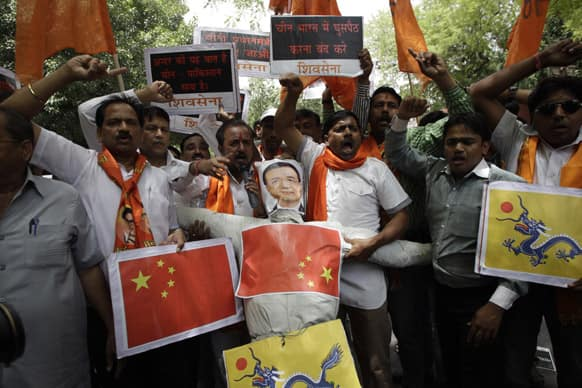 About two dozen members of Shiv Sena, a Hindu right-wing political party, prepare to burn an effigy of Chinese Premier Li Keqiang as they demonstrate near India`s Parliament, in New Delhi.