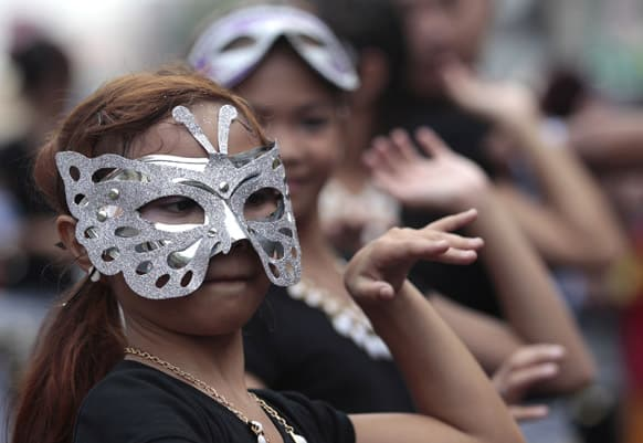 Filipino girls dressed in costume dance during a parade to mark the feast day Saint Rita de Cascia in suburban Paranaque City, south of Manila.