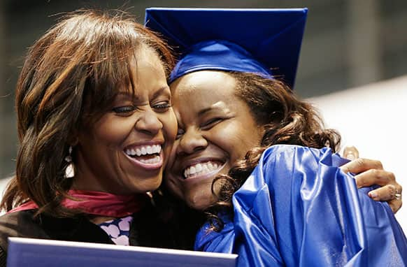 First lady Michelle Obama hugs Jenika Headley-Greene as Obama hands out diplomas during the graduation ceremony for Martin Luther King Jr. Academic Magnet High School, in Nashville, Tenn.