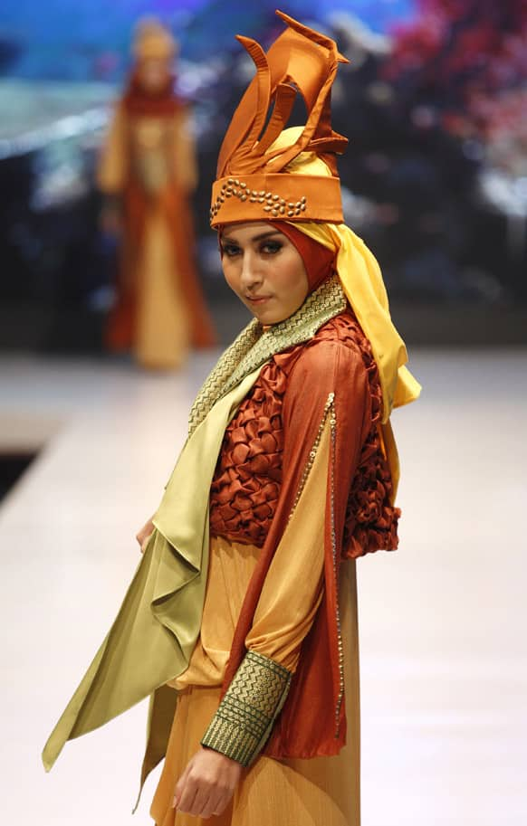 A model presents creation by Indonesian designer Lia Afif during the Jakarta Fashion and Food Festival.