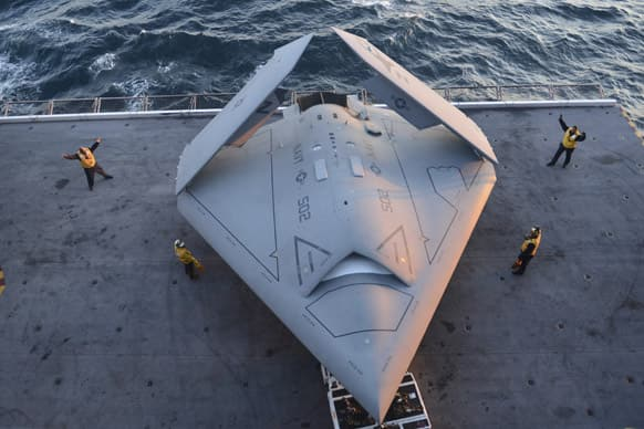 This image provided by the US navy shows sailors moving an X-47B Unmanned Combat Air System (UCAS) demonstrator onto an aircraft elevator aboard the aircraft carrier USS George H.W. Bush.