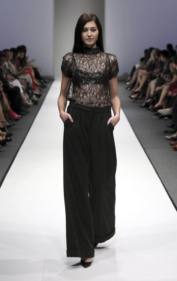 A model showcases an outfit from the A/W 2013 collection by Australian designer Collette Dinnigan during the annual Audi Fashion Festival, in Singapore.