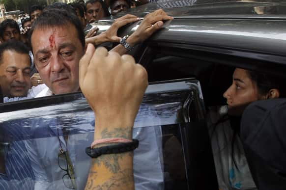 Sanjay Dutt arrives with wife Manyata to surrender before a court in Mumbai.