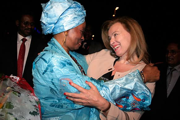 Valerie Trierweiler, right, companion of French President Francois Hollande, is greeted by Mali`s first lady Mintou Doucoure as she arrives at the airport in Bamako, Mali.