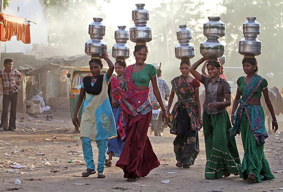 Indian village girls carry water in pitchers on their heads at Juval village, about 40 kilometers from Ahmadabad.