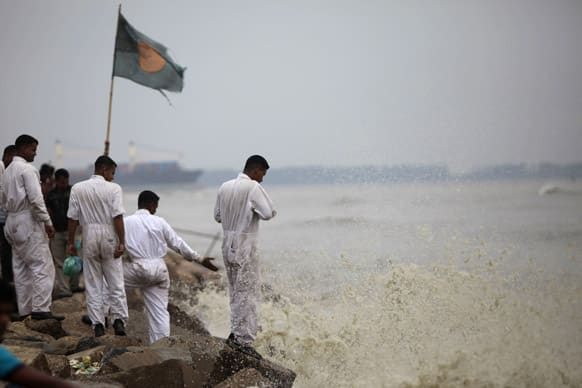 Bangladeshi marine sailors stand on the banks of the Bay of Bengal sea, as they prepare for the coming of tropical cyclone Mahasen, in Chittagong, Bangladesh.