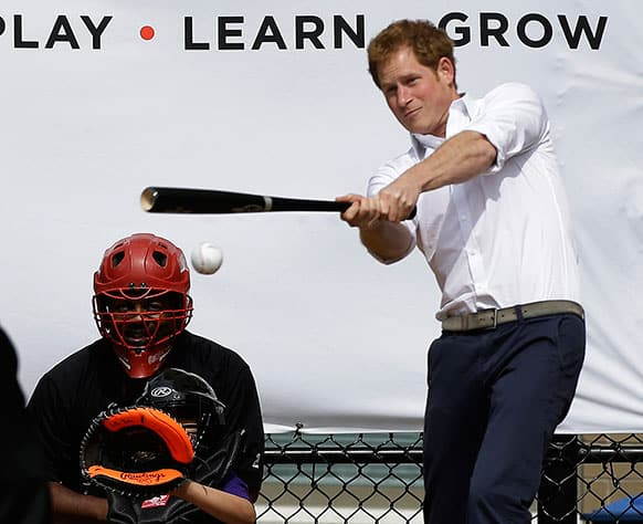 Britain`s Prince Harry hits a ball pitched to him by New York Yankees first baseman Mark Teixeira during a visit to Harlem RBI`s baseball program in New York, to launch a partnership between the organization, the Royal Foundation of the Duke and Duchess of Cambridge, and Prince Harry.