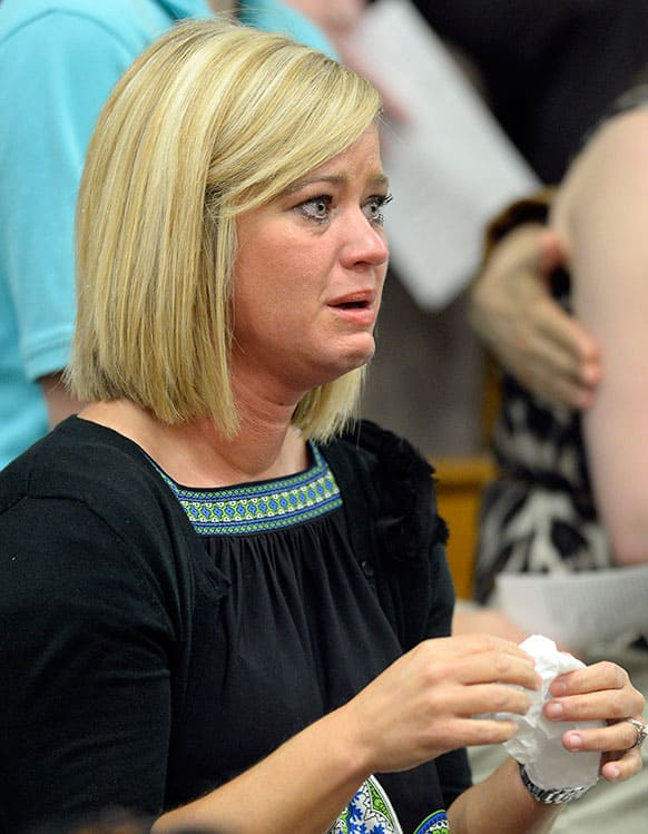 Stephanie Wardrip of Danville, Ky. fights back tears during the memorial service remembering the 25th anniversary of the Carrolton bus crash at North Hardin High School in Radcliff, Ky.