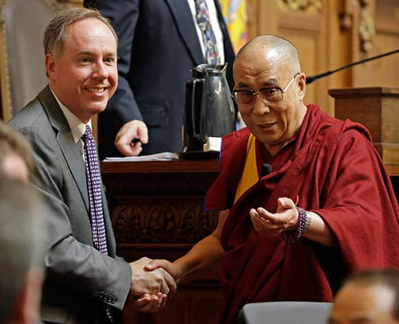 The Dalai Lama talks to Assembly Speaker Robin Vos after speaking to the Wisconsin state Assembly in Madison, Wis.