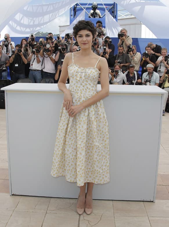 Actress Audrey Tautou, who will host the Cannes Film Festival opening ceremony on Wednesday, poses for photographers at the 66th international film festival, in Cannes.