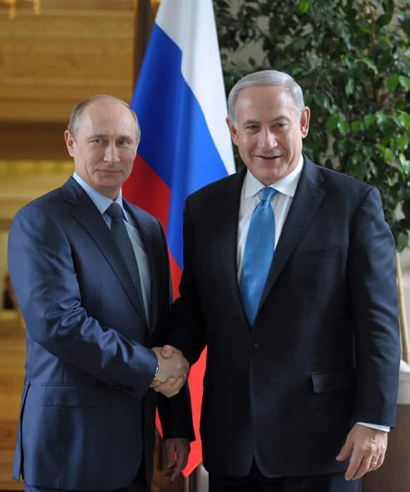 Russian President Vladimir Putin, left, shakes hands with Israeli Prime Minister Benjamin Netanyahu during their meeting at the Bocharov Ruchei residence in the Black Sea resort of Sochi, Russia.