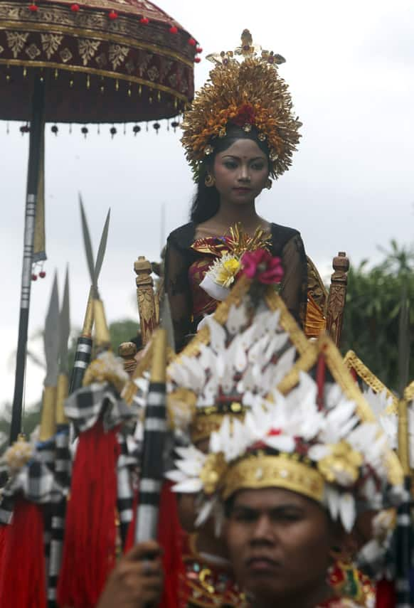 A member of Ubud royal family attends a funeral procession of Tjokorde Ngurah wim Sukawati, a deceased member of the Ubud Royal family, to the cremation ceremony in Ubud, Bali, Indonesia.
