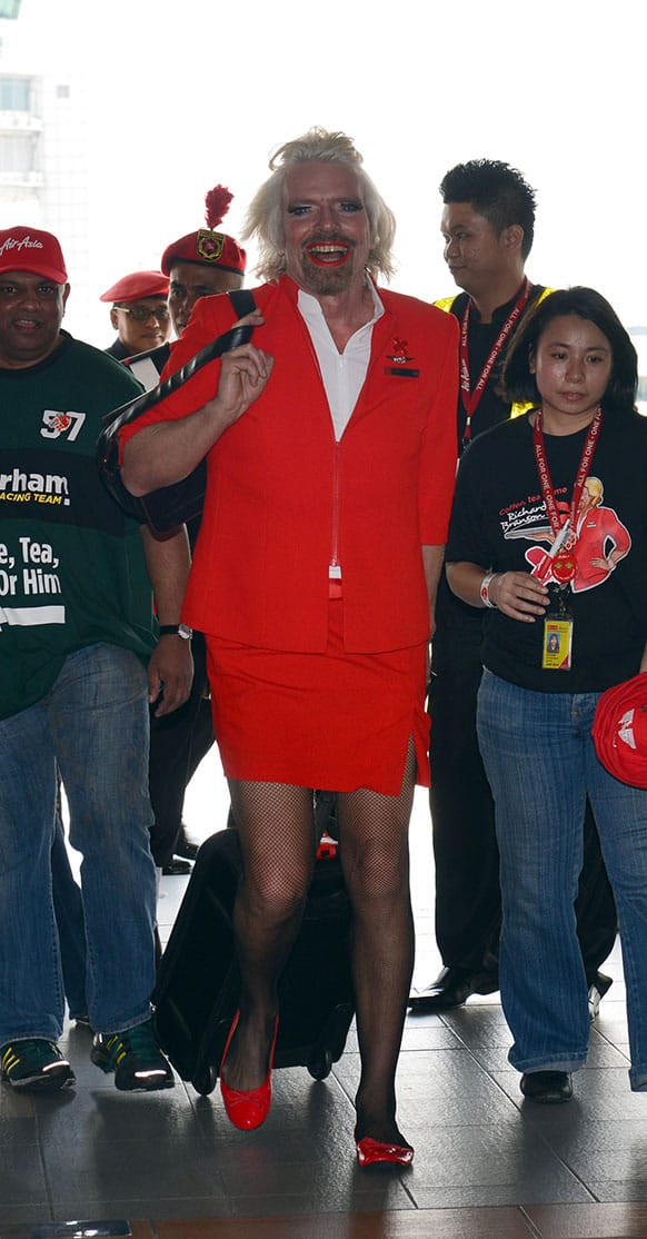 British entrepreneur Richard Branson arrives at a low cost carrier terminal dressed up as an AirAsia stewardess from a flight from Australia to Malaysia.