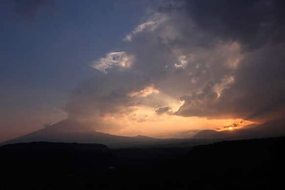 The Popocatepetl volcano spews ash and steam as seen from Santiago Xalitzintla, Mexico.