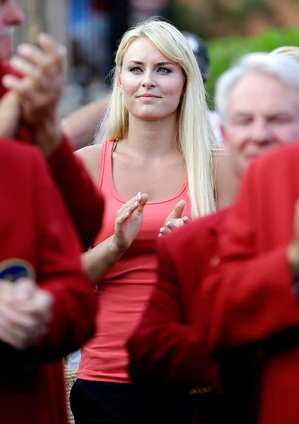 Skier Lindsey Vonn applauds as her boyfriend Tiger Woods receives the trophy after winning The Players Championship golf tournament at TPC Sawgrass, in Ponte Vedra Beach, Fla.
