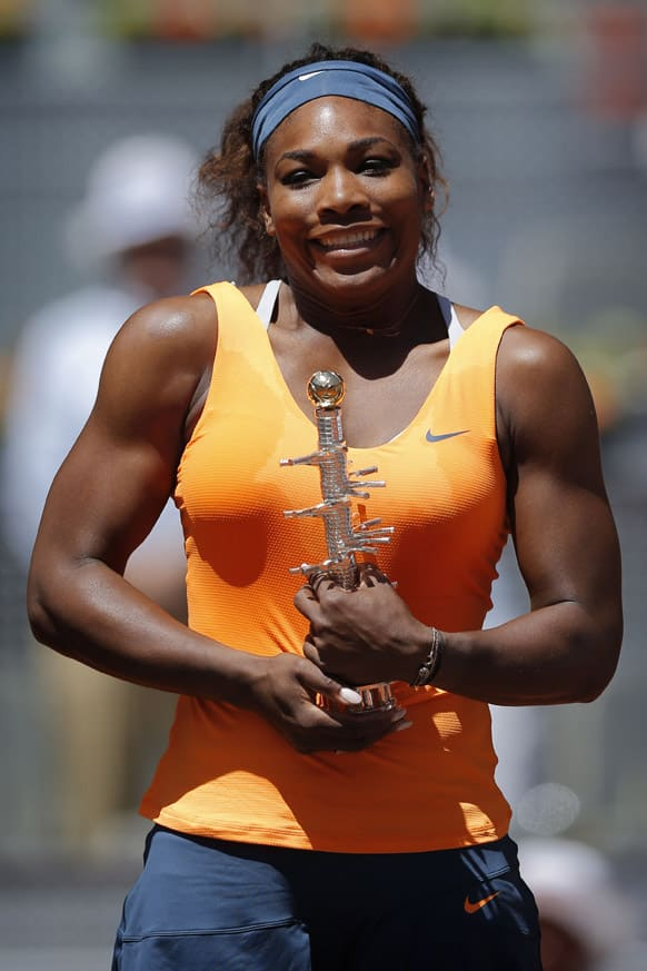Serena Williams from the US poses with her trophy during the awards ceremony after winning the final of the Madrid Open tennis tournament against Maria Sharapova from Russia, in Madrid.