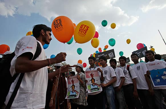 Indians participate in a Let's Vote campaign in Hyderabad.