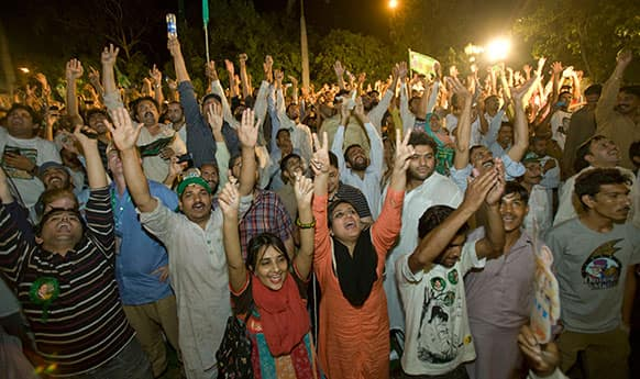 Supporters of Pakistan Muslim League-N party celebrate the primary unofficial results for the country`s parliamentary elections at the party`s headquarter in Lahore, Pakistan.