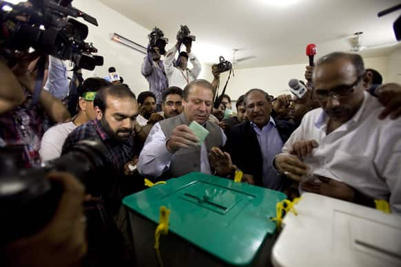 Former Prime Minister Nawaz Sharif casts his vote at a polling station during the country`s parliamentary election in Lahore, Pakistan.