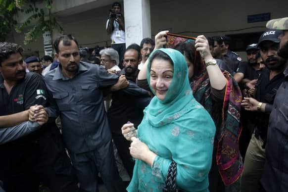 Kalsoom Nawaz, the wife of former prime minister and Pakistan Muslim League-N party chief Nawaz Sharif, walks out of a polling station after casting her ballot in Lahore, Pakistan.