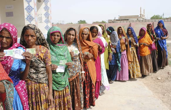 Pakistani women line up outside a polling station waiting to cast their ballots in Hyderabad, Pakistan.
