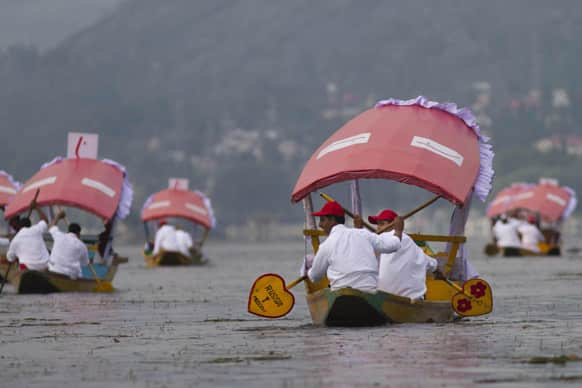 Kashmiri boatmen row their Shikara, or traditional gondola, during a race on the Dal Lake in Srinagar. The race was organized by a private hotel chain to boost high-end tourism and to revive the sport in Kashmir.