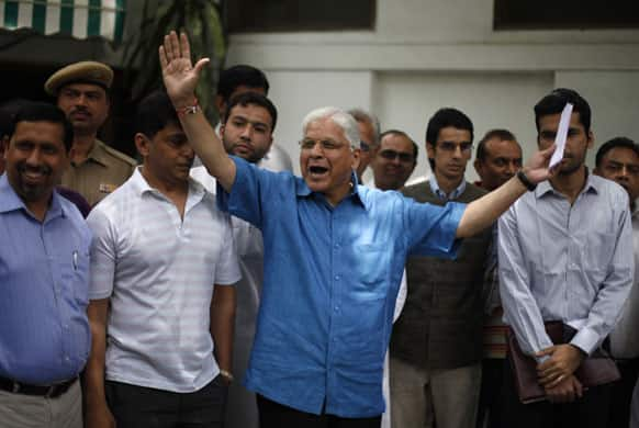 Former Indian Law Minister Ashwani Kumar greets media personnel as he arrives to address a press conference, a day after submitting his resignation in New Delhi.