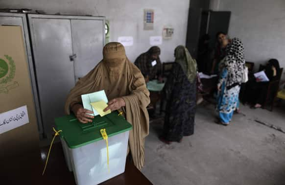 A Pakistani woman casts her ballot at a polling station on the outskirts of Islamabad.