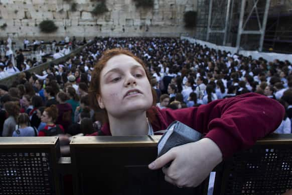 A Jewish orthodox women follows a prayer organized by the