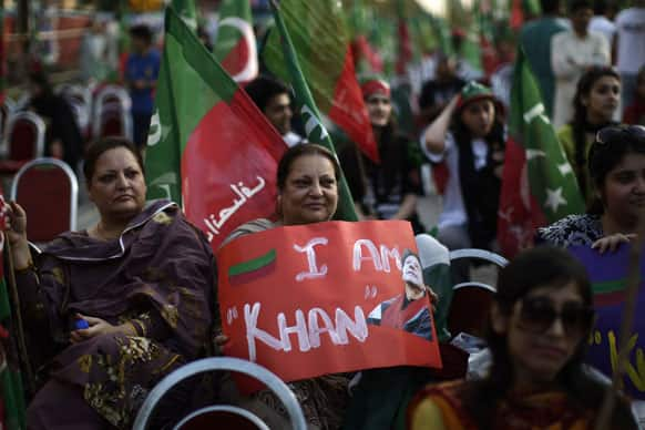 Pakistani supporters of former cricket star-turned-politician, and leader of Pakistan Tehreek-e-Insaf party, Imran Khan, attend a rally in Islamabad, Pakistan.
