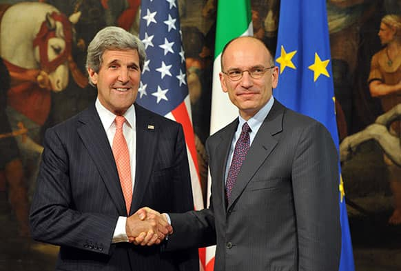 Italian Prime Minister Enrico Letta, right, shakes hands with US Secretary of State John Kerry at the Palazzo Chigi in Rome.