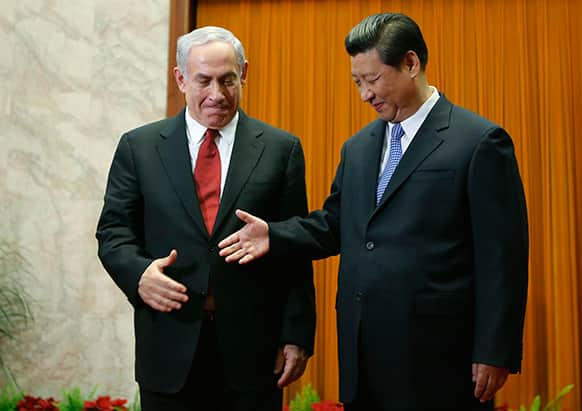Israel`s Prime Minister Benjamin Netanyahu, left, prepares to shake hands with China`s President Xi Jinping at the Great Hall of the People in Beijing.