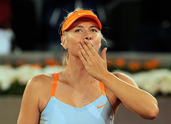 Maria Sharapova from Russia celebrates her victory during a match against Christina McHale from U.S. at the Madrid Open tennis tournament.