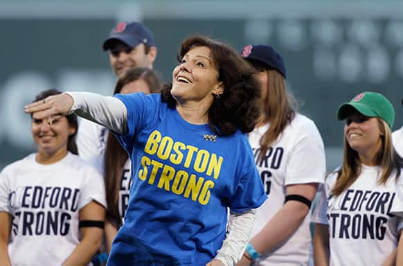 Patty Campbell, of Medford, Mass., mother of Krystle Campbell, who was killed in the Boston Marathon bombing, throws out a ceremonial first pitch prior to a baseball game between the Boston Red Sox and the Minnesota Twins at Fenway Park in Boston.
