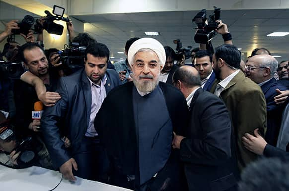 Former Iranian nuclear negotiator Hasan Rowhani, center, arrives at the interior ministry to register his candidacy for the upcoming presidential election, in Tehran, Iran.