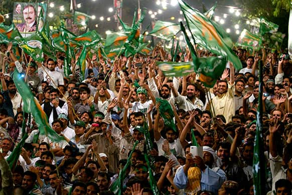 Supporters of Pakistan Muslim League-N party cheer their leader, Nawaz Sharif, not pictured, during an election campaign rally in Islamabad, Pakistan.