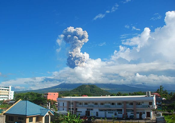 A mushroom of volcanic ash shoots up to the sky as Mayon volcano, one of the Philippines` most active volcanoes, spewed huge rocks and ash after daybreak Tuesday, May 7, 2013.