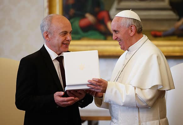 Pope Francis exchanges gifts with the President of the Swiss Confederation Ueli Maurer during a private audience at the Vatican.