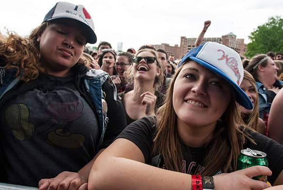 Shannon Petree, right, of Huntington West Virginia, watches the band Delta Spirit perform during the inaugural Shaky Knees Music Festival in Atlanta.