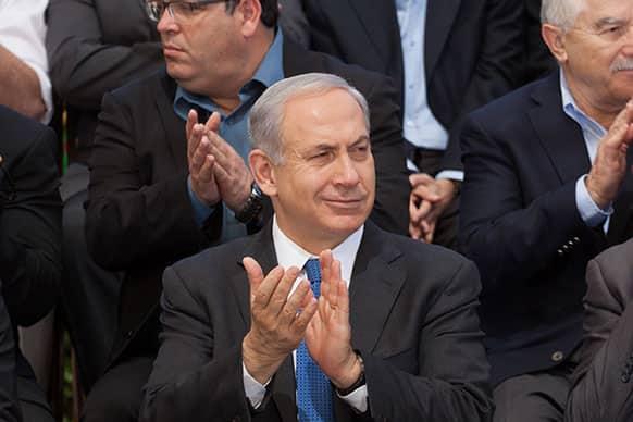 Israeli Prime Minister Benjamin Netanyahu applauds as he attends the weekly cabinet meeting at the Herzl Museum, in Jerusalem, Israel.