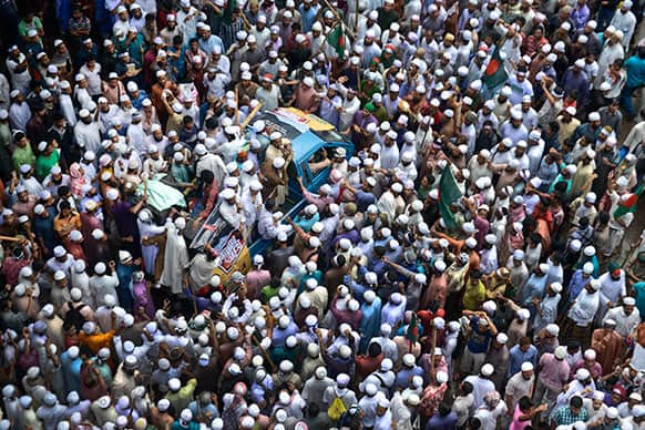 Hefazat-e Islam protesters block one of entry points to the city in Dhaka, Bangladesh. Protesters were demanding that the Bangladesh government enact an anti-blasphemy law, but leaders in the Muslim-majority nation rejected the demand, saying the country is governed by secular liberal laws.
