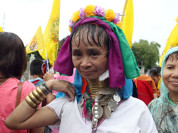 Ma Se, 40, a long neck hilltribe woman, joins a gathering to honor Thailand`s King Bhumibol Adulyadej during the coronation day celebrations in Bangkok, Thailand.