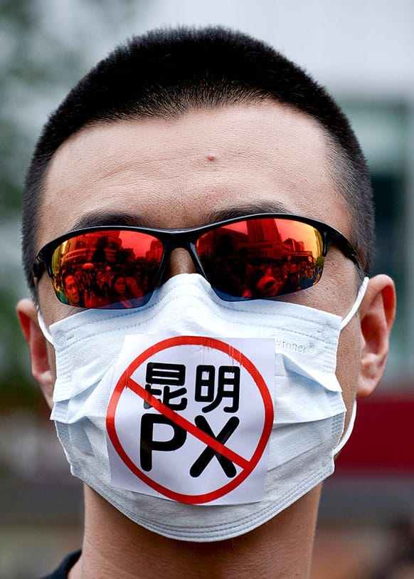 A Chinese man wears a face mask with the word