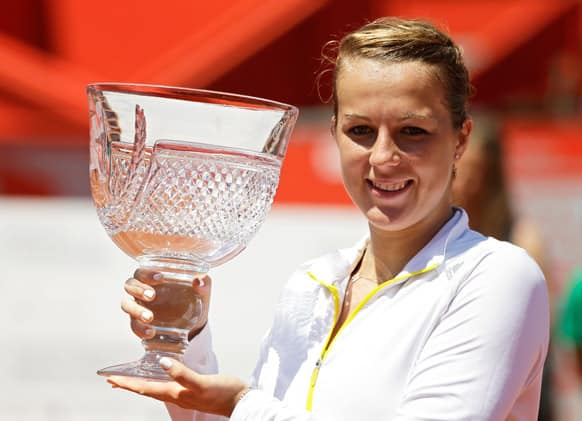 Russia`s Anastasia Pavlyuchenkova holds the trophy after winning the Portugal Open final tennis match in Oeiras, outside Lisbon. Pavlyuchenkova defeated Spain`s Carla Suarez Navarro 7-5, 6-2.